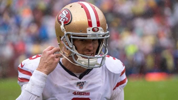 San Francisco 49ers kicker Robbie Gould taking his helmet off.