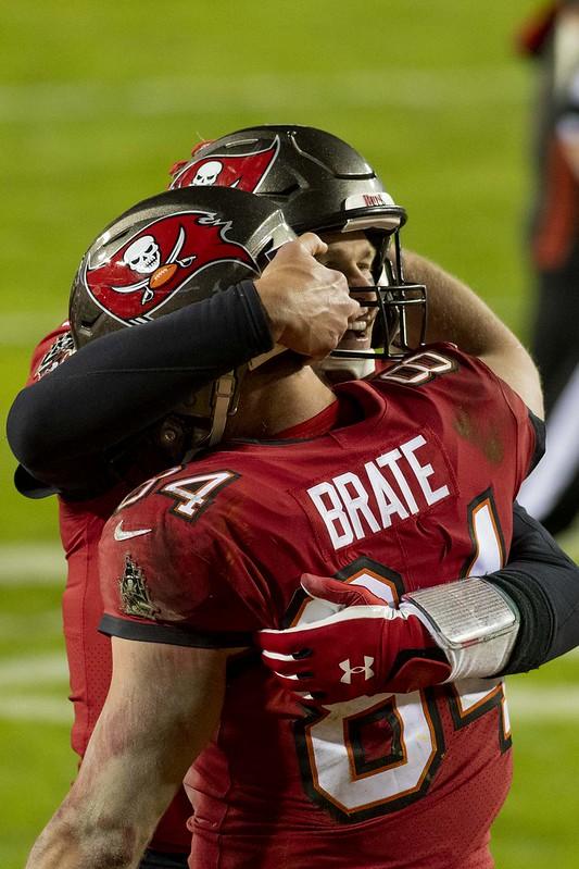 Tampa Bay Buccaneers quarterback Tom Brady giving teammate tight end Cameron Brate a celebratory hug.