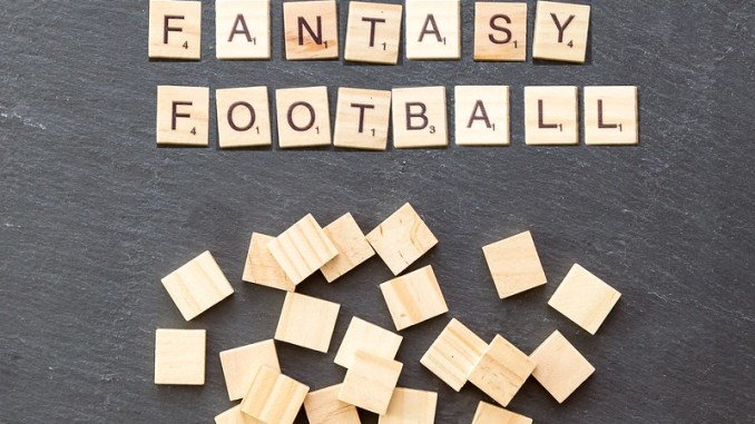 The words FANTASY FOOTBALL spelled out in scrabble tiles