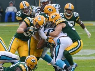 NFL Green Bay Packers defense tackling Carolina Panthers running back Christian McCaffrey