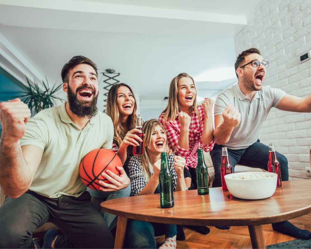 A group of friends watching a basketball game at home