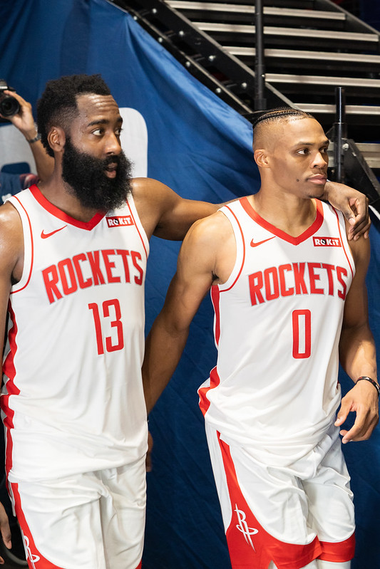 James Harden with his arm around Russell Westbrook