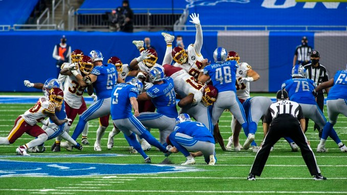 NFL Detroit Lions kicker Matt Prater attempting a field goal against the Washington Football Team.