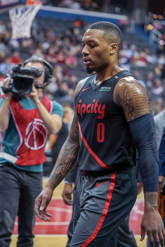 NBA Portland Trail Blazers point guard Damian Lillard walking off the basketball court after a basketball game.