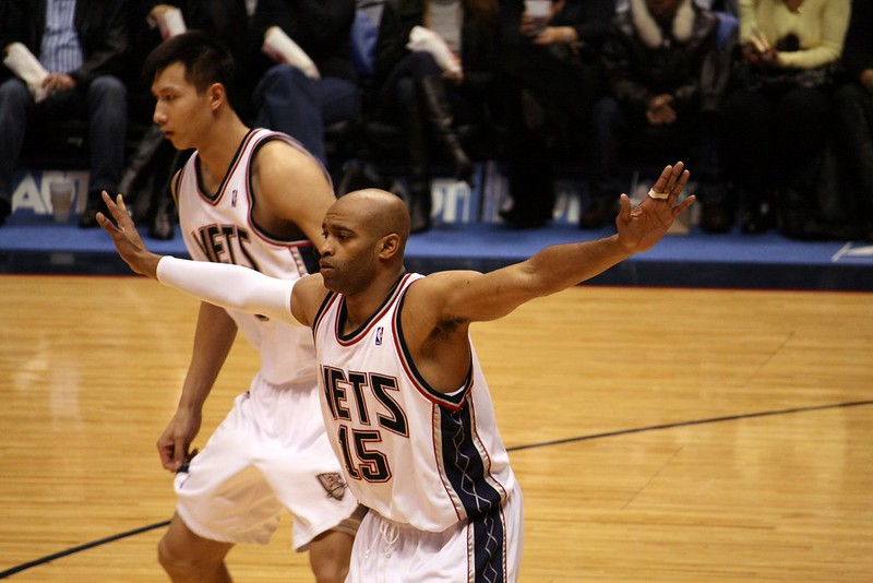 NBA legend shooting guard Vince Carter playing defense for the New Jersey Nets.