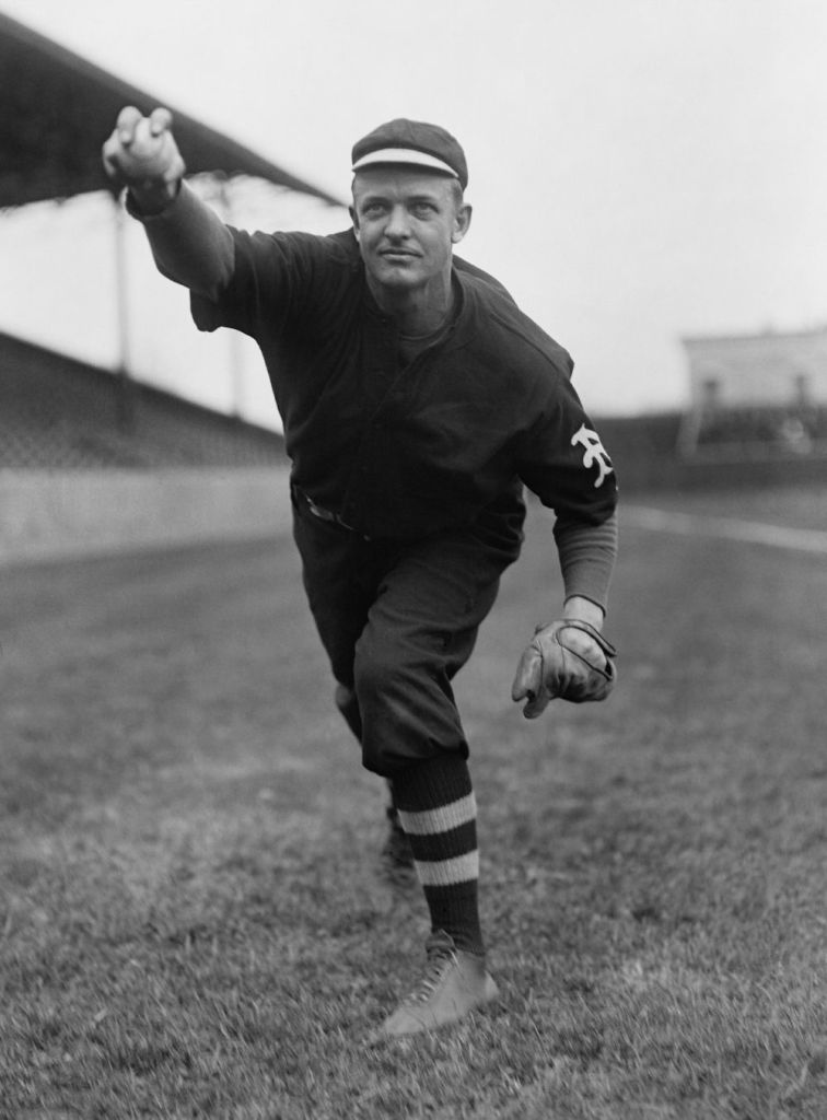Christy Mathewson, New York Giants pitcher, warming up before a game.