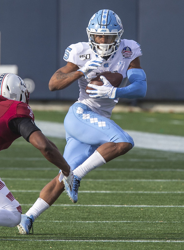 Former University of North Carolina wide receiver Dazz Newsome running after catching the football.
