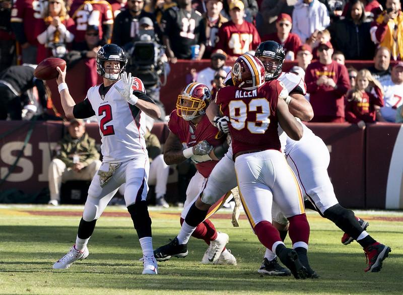 Atlanta Falcons quarterback Matt Ryan throwing a pass against the Washington Football Team defense.