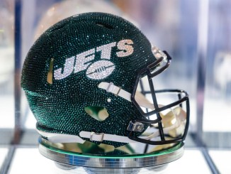 A New York Jets crystal helmet on display at the 2021 NFL Draft Experience in Cleveland, Ohio.