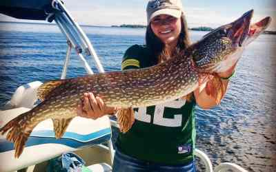 Girl catches a monster 40 inch northern pike in Wisconsin.