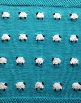 wełniany kocyk w owieczki