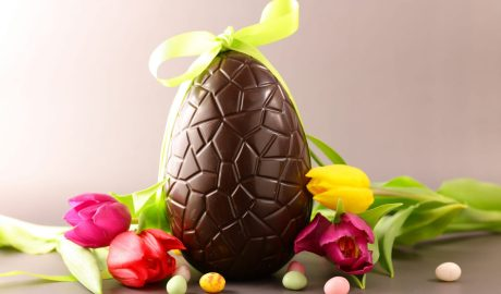 A big easter chocolate egg with tulips