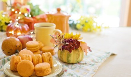 pumpkinmacarons with cup of coffee and flowers