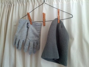 Clothes pins holding drying gloves