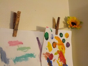 Kevin's Quality Clothespins holding up Kids Art