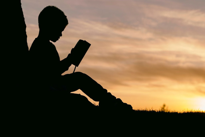 kid reading independently