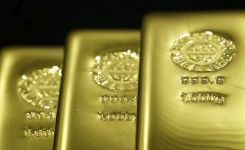 Fed Fusillade Sends Gold to $100 Loss This Month as Dollar Rises