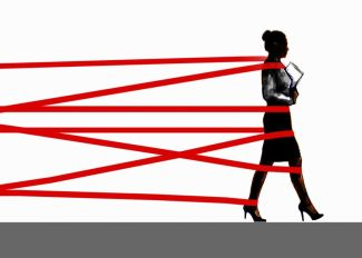 Businesswoman being held back by red tape