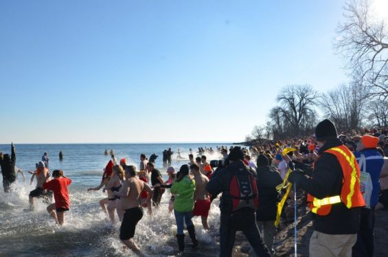 Participants running into water for the Courage Polar Bear Dip for World Vision.