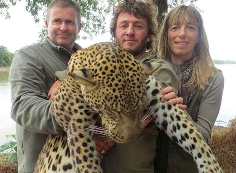 Trophy hunt with dead leopard