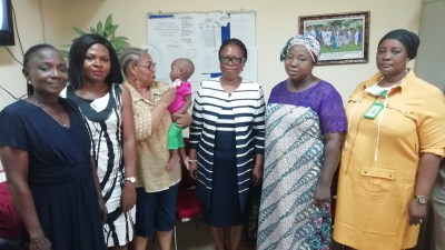 The Secretary LHCHF, Dr. Francisca Odeka presenting The PTAP Medical Grant Receipt and Acknowledgement letter to Mrs. Ngozi Nwobi of Lady Dorcas Foundation.