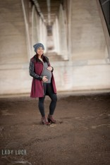 winter-maternity-portrait-in-saskatoon-standing-under-the-bridge-down-by-the-river