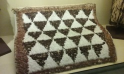 This looks like a more modern quilt to your eyes but you'd be wrong. It's a feather cape from the Maori