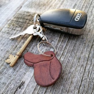 A mid brown gp saddle keyring, displayed on a bunch of keys