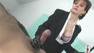 Strict mistress cock milking in leather gloves