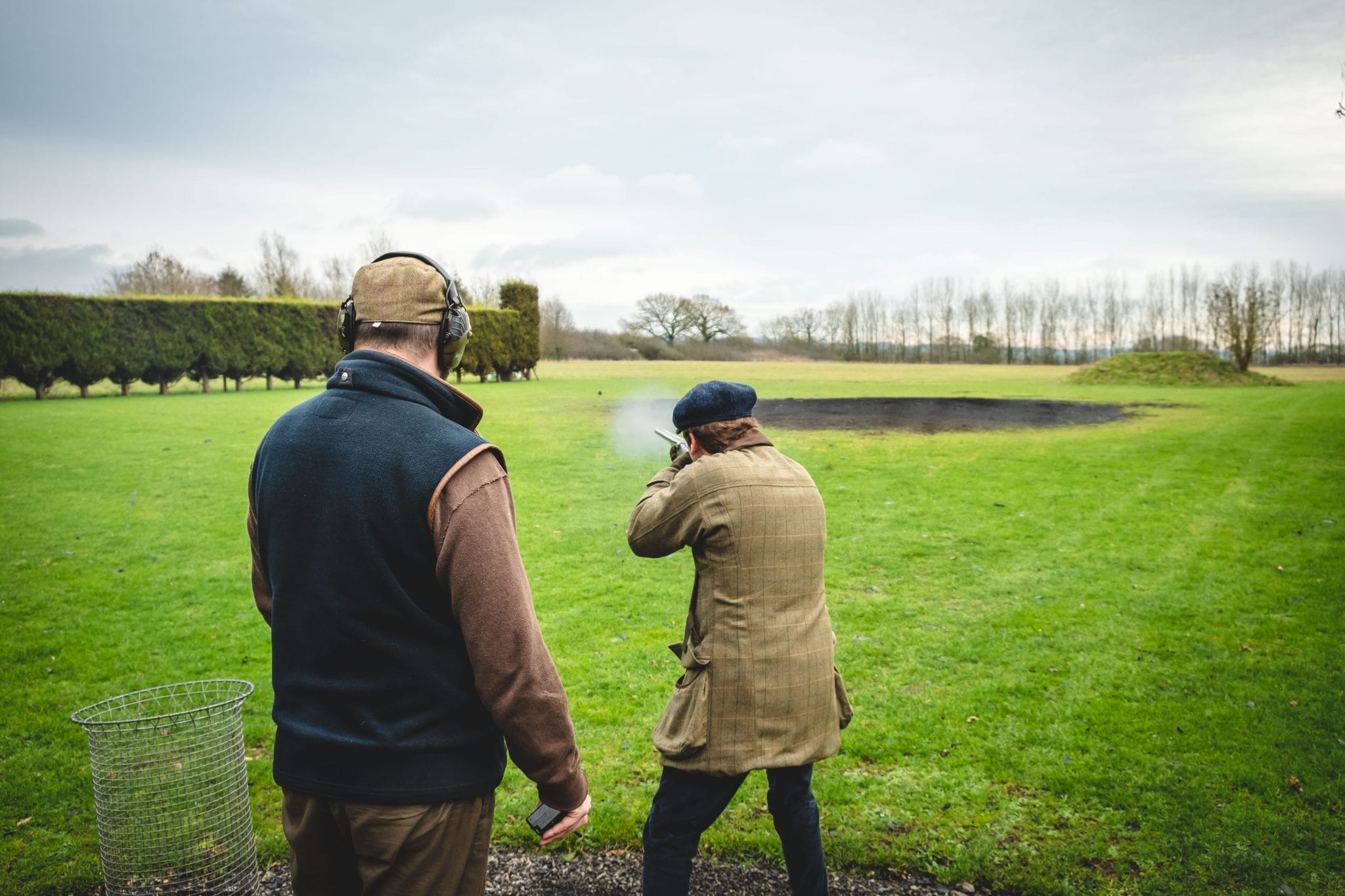 A customer shoots the rabbit layout on a game shooting lesson at Lady's Wood Shooting School