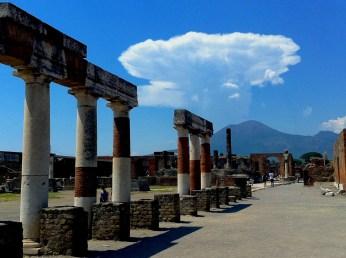 Streets of Pompeii and Vesuvius volcano.