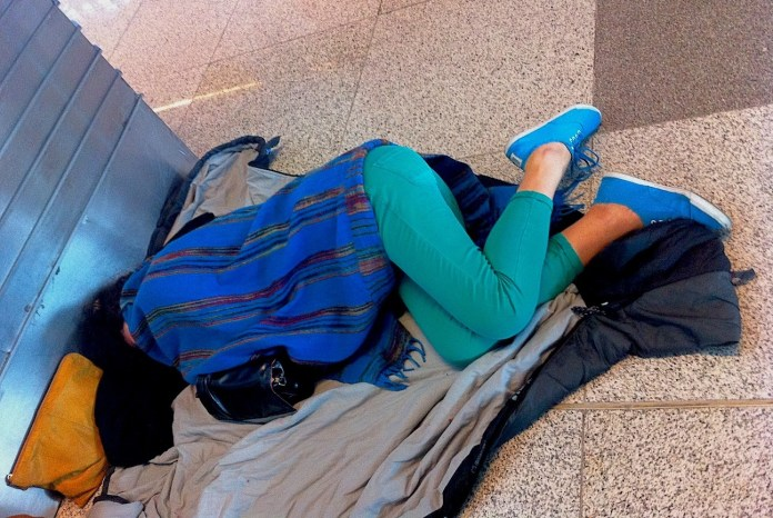 Me, sleeping in New Delhi airport (India)