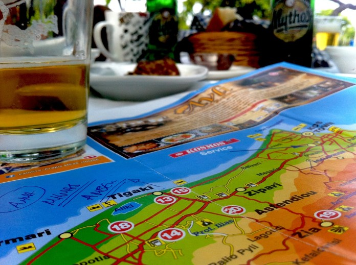 Planning the further road trip in Kos while waiting for our meals
