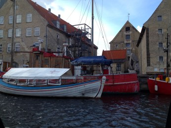 Boat touring in Copenhagen through the canals