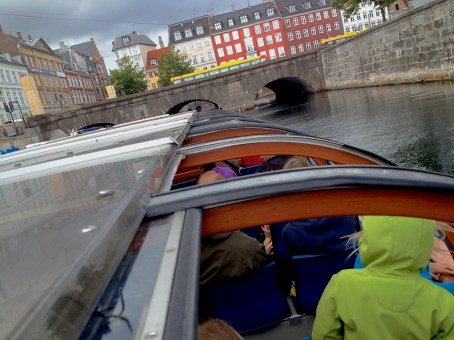 Boat touring in Copenhagen through the canals: we've got a really close acquaintance with all the tiniest and narrowest bridges, just a few millimeters wider than our boat...