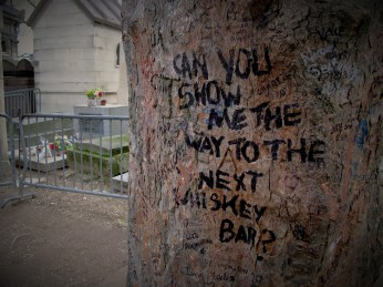 Jim Morrison's grave and some lyrics on the tree in Père Lachaise Cemetery a few year ago.