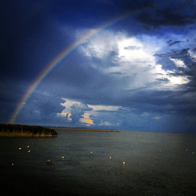 Beautiful rainbow over the Curonian Lagoon in Nida, Lithuania