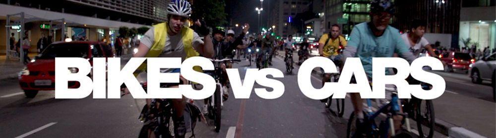 BIKES vs CARS Title image 2; Ghost bike memorial ride, Sao Paulo, Brazil. P hoto: Flora Dias