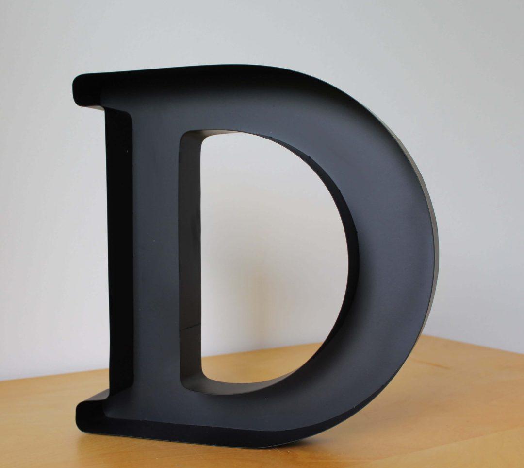 Lettre D porte bouchon