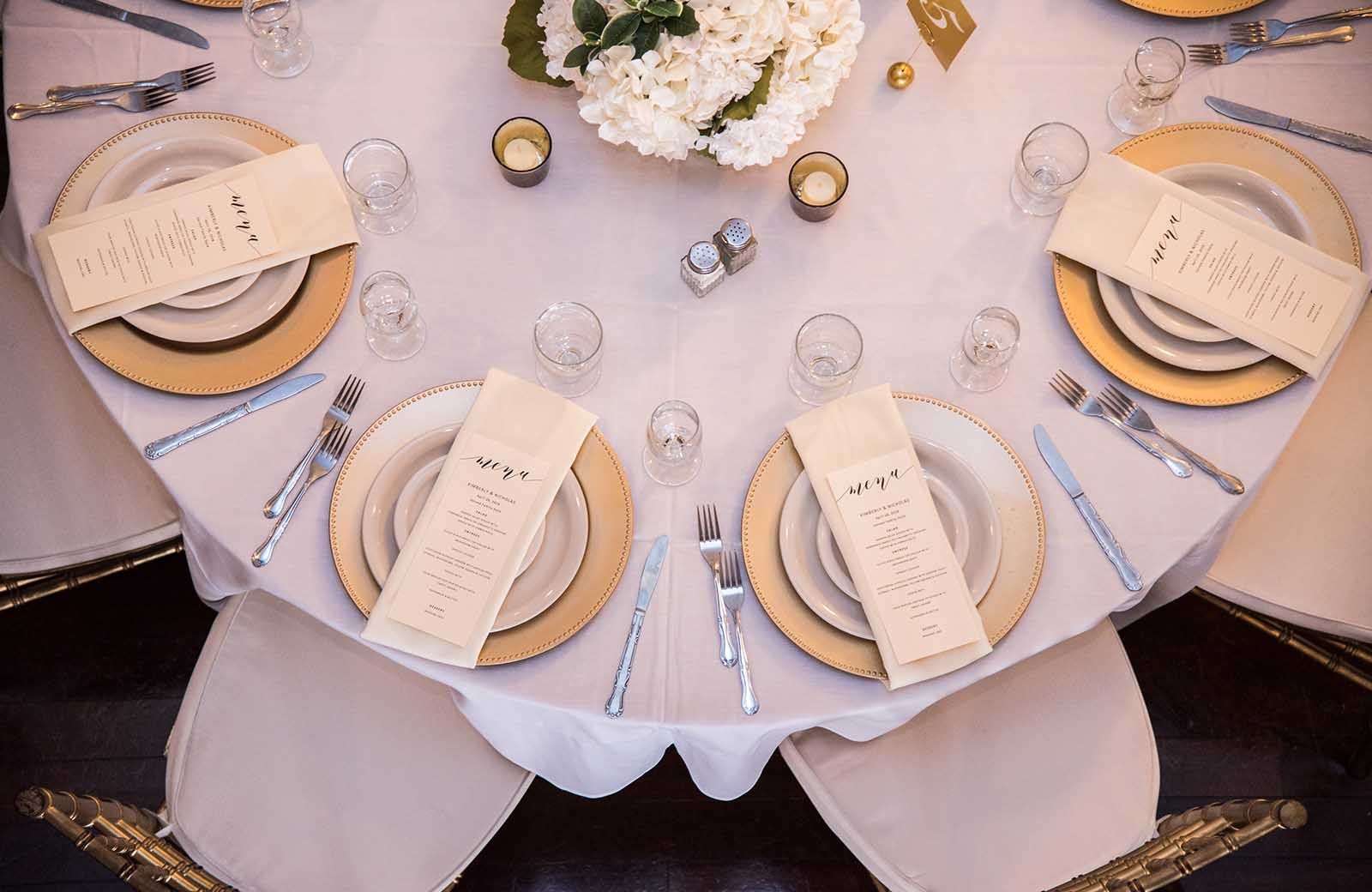 Table settings and decor in the Grande Ballroom at the Lafayette Grande.