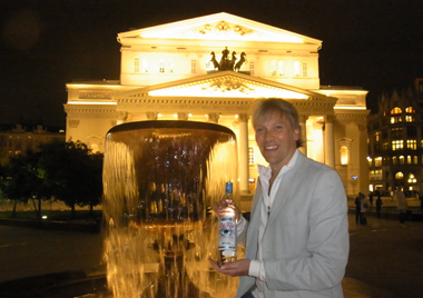 George Rowley with bottle of La Fée Blanche outside Bolshoi
