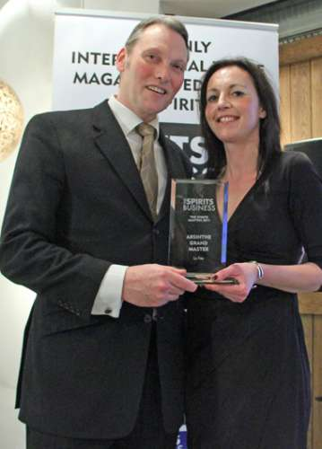 George Rowley receiving the Absinthe Masters award from Daisy Jones, Spirits Business associate publisher