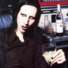Marilyn Manson with bottle of La Fée absinthe