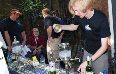 Oscar Dodd pouring a drink of La Fée absinthe