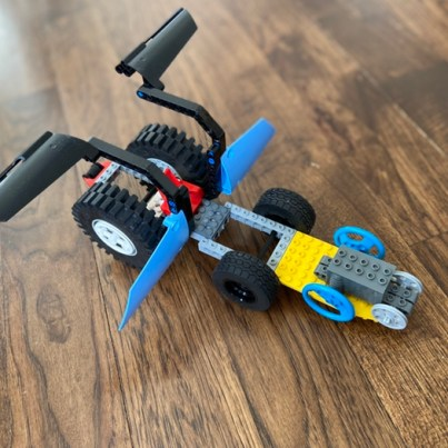 Cool Vehicle: I wanted to create a vehicle that can fly and go on all kinds of terrains. The vehicle has a winch and platform in the front for a mini exploring vehicle.