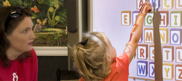 preschooler using a smart board