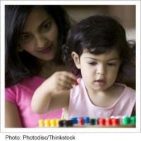 preschool child playing with blocks