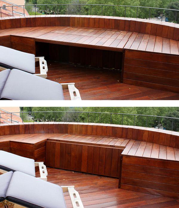 banco de madera de exterior de ipe en jardin en atico