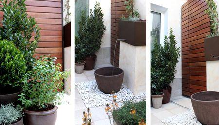 Jard n de dise o con fuente la habitaci n verde for Disenos de patios modernos