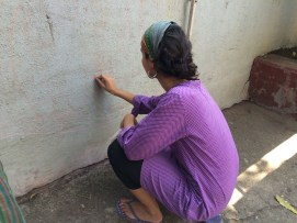 Drawing the concept on the wall with Chalk